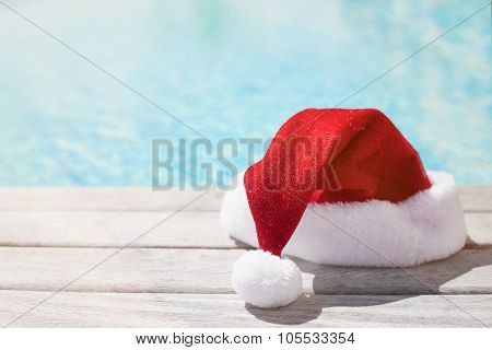 Red Christmas hat sitting by the pool