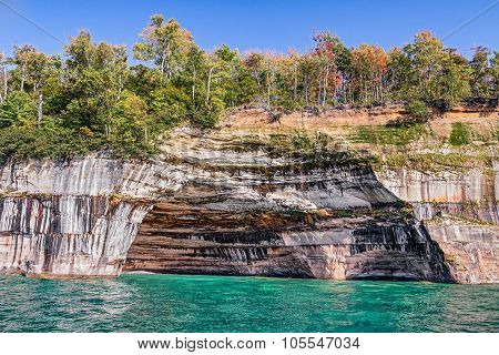 A large rock alcove adorns the cliffs at Pictured Rocks National Lakeshore on the Upper Peninsula Michigan Coast of Lake Superior. poster