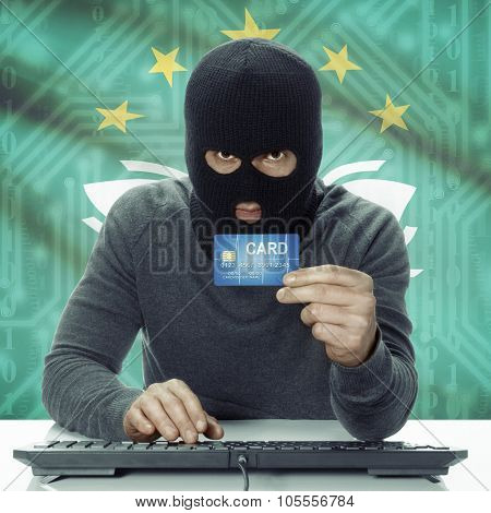 Dark-skinned Hacker With Flag On Background Holding Credit Card - Macau
