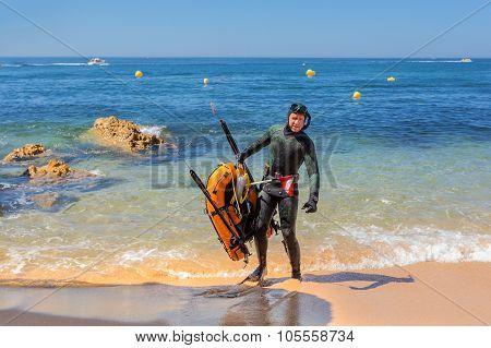 Underwater Hunter In Flippers Preparing To Dive. Underwater Fishing In The Atlantic Ocean.