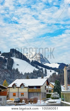 Small Town Of Gruyere Covered In Snow With The Swiss Mountains In The Background