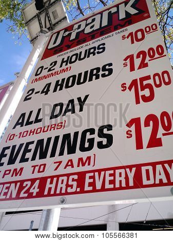 Paid Parking Sign with Hourly Fees in Seattle, Washington on September 15, 2015