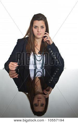 Young European Business Girl Over Black Mirror