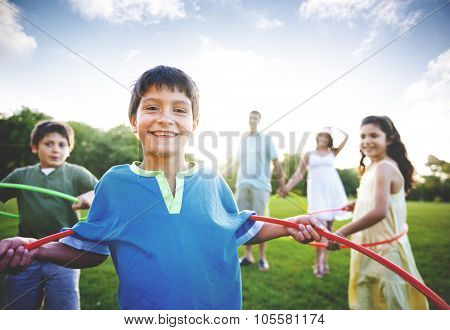 Whole Family Hula Hooping Outdoors Togetherness Concept