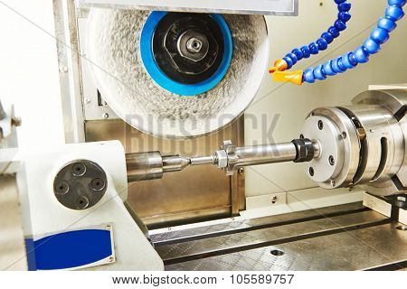 metalworking  industry. polishing and finishing grinding machine with metal cogwheel gera in workshop.  poster