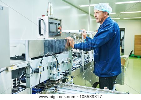 pharmaceutical factory man worker operating production line at pharmacy industry manufacture factory