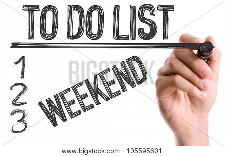 Hand with marker writing: To Do List: Weekend