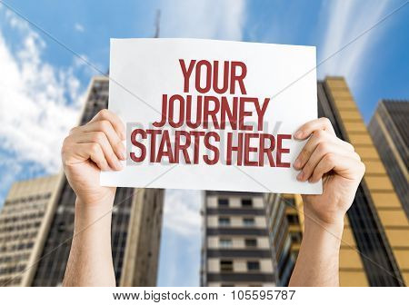 Your Journey Starts Here placard with urban background