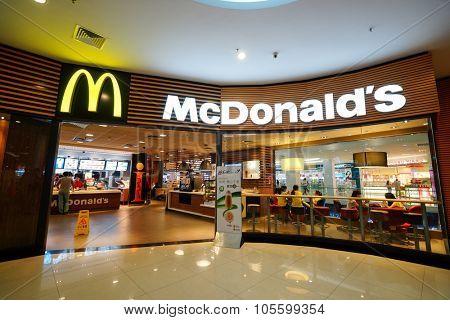 SHENZHEN, CHINA - OCTOBER 09, 2015: McDonald's restaurant interior. McDonald's primarily sells hamburgers, cheeseburgers, chicken, french fries, breakfast items, soft drinks, milkshakes, and desserts