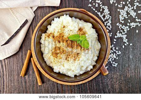 Rice Porridge With Cinnamon In Bowl On Board Top