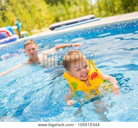 Child playing in swimming pool