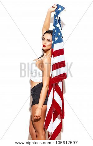 Sexy Woman Holding Usa Flag At White Wall