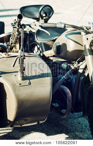 Detail of machine gun mounted on the veteran sidecar. Retro military scene. poster