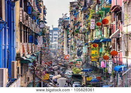 YANGON, MYANMAR - OCTOBER 18, 2015: Alleyway in Yangon in front of Bogyoke Market. Yangon is the country's largest city.