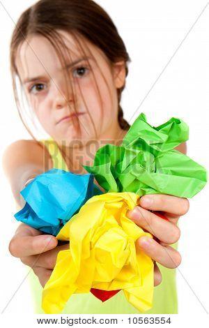 Grumpy Girl Holding Crumpled Paper Balls