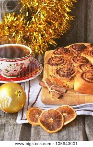 Baking on the wooden table with cinnamon and christmas toys, toned photo
