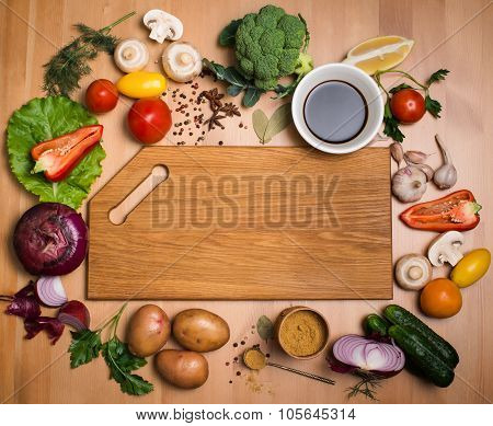 Various Vegetables And Spices And Empty Cutting Board. Colorful Ingredients For Cooking On Rustic Wo