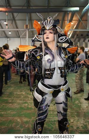 MOSCOW - OCT 12, 2014: The girl in a fantastic costume cosplayer at the EveryCon 2014 in the exhibition center Sokolniki