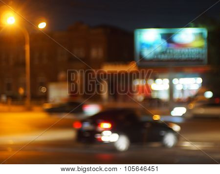 Abstract Blurred Image Of A Car Driving In The City