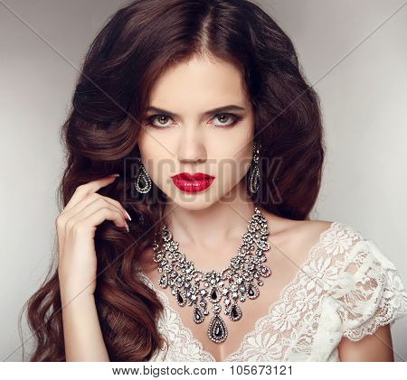 Fashion Earrings And Necklace. Beauty Girl Portrait. Hairstyle. Makeup. Jewelry. Beautiful Woman Wit
