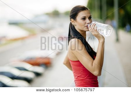 Thirsty Woman Drinking Water To Recuperate
