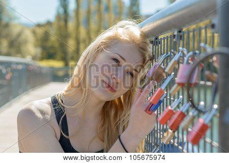 Beautiful Young Blond Woman Holding Padlocks