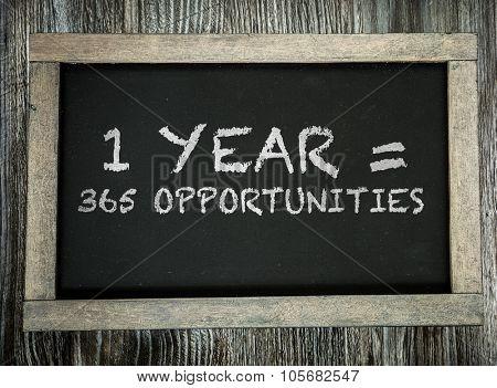 1 Year = 365 Opportunities written on chalkboard