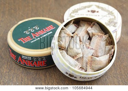 MOSCOW, RUSSIA - June 02, 2015: Jars of swedish Islay Whisky snus and Tre Ankare snus (chewing tobacco) closeup. Shallow DOF!