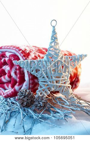 Natural christmas decoration with star and blanket.