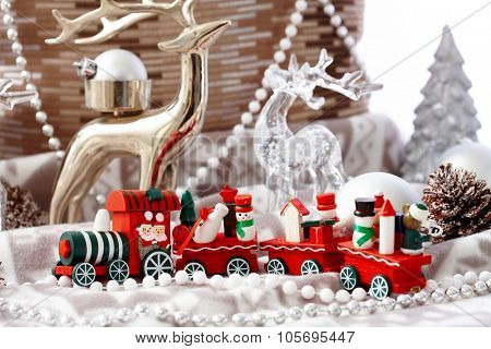 Lovely christmas decoration with small red train and pastel ornaments.