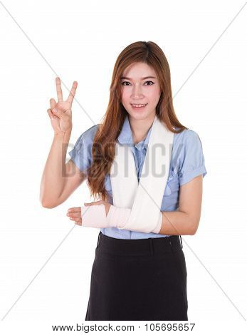 woman with an injured arm wrapped in an Elastic Bandage (victory sign) isolated on white background poster