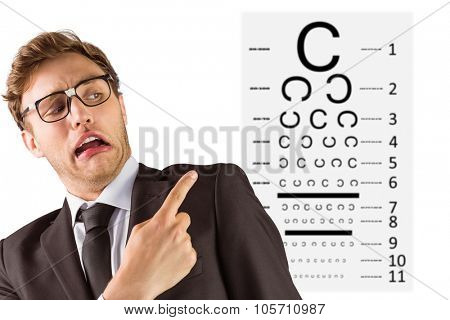 Young geeky businessman pointing to shoulder against eye test