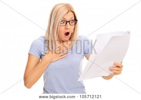 Baffled young woman looking at a piece of paper in disbelief isolated on white background