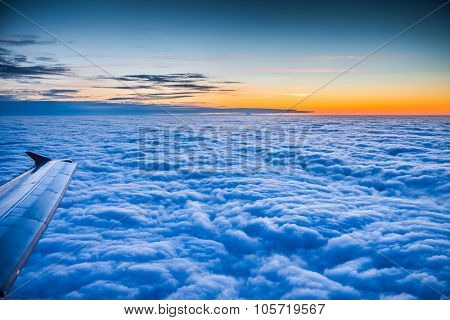 flying above the beautiful clouds in the evening sky