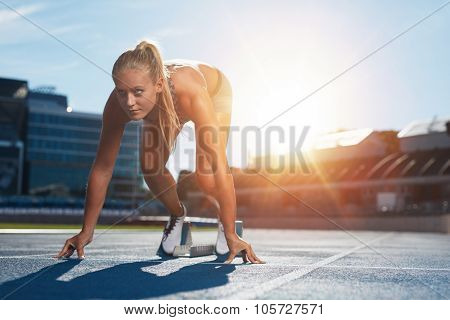 Professional Female Track Athlete On Sprinting Blocks