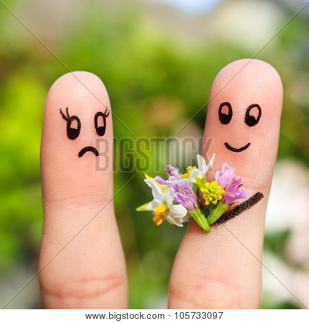 Finger art of couple. Man gives a woman a bouquet of flowers, she is not satisfied.