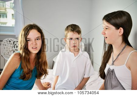 Three Children Look With Disgust