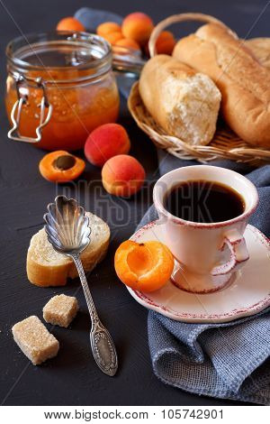 Apricot jam in jam jar, French baguette and cup of coffee poster