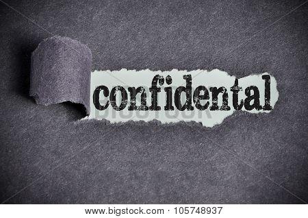 Confidental Word Under Torn Black Sugar Paper