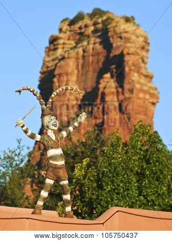 A Clown Dancer And Red Butte Spire