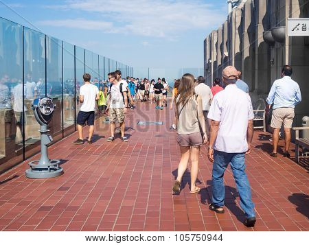 NEW YORK,USA - AUGUST 15,2015 : Tourists at the Top of the Rock observatory atop the GE Building, part of the Rockefeller Center