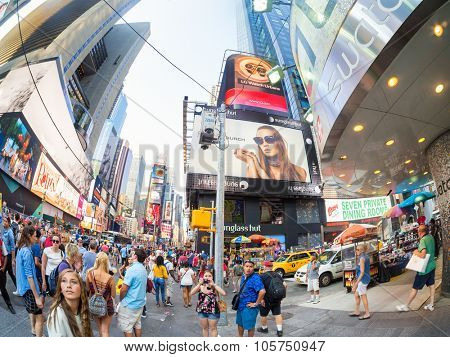NEW YORK,USA - AUGUST 14,2015 : Tourists at Times Square in New York City