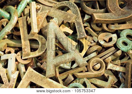 Ructic Metal Letters Dumped In A Pile Of Scrap Metal