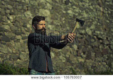Stony Wall And Man With Ax