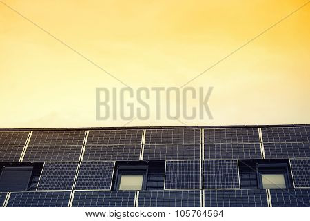 Solar Panels Against Yellow Sky
