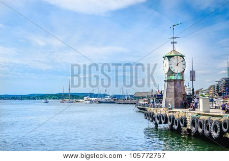 Famous clock tower in Oslofjord, Oslo, Norway