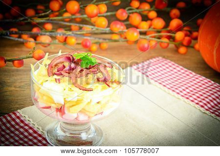 Salad of crab sticks, apple, eggs, cheese