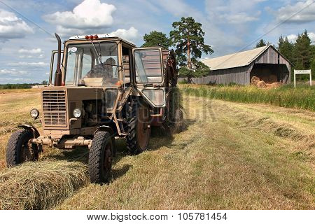 Haymaking Time, Russian Farm Tractor With Round Baler Harvests Hay.