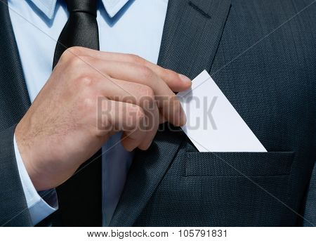 Close up of business man hand who takes out business card from the pocket of business suit