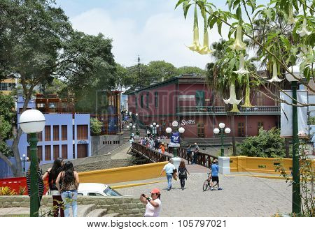 BARRANCO, PERU - OCTOBER 18, 2015: Bridge of Sighs. Tourists and locals crossing the Bridge of Sighs in the Barranco district of Lima Peru.